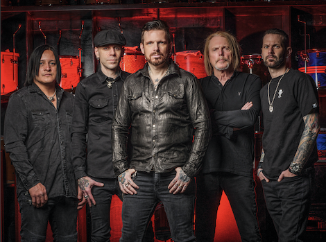 Members of Black Star Riders Standing In Front Of A Black And Red Backdrop