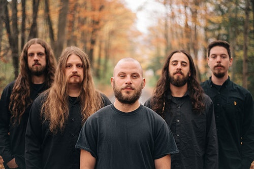 Rivers Of Nihil band members standing in a forest