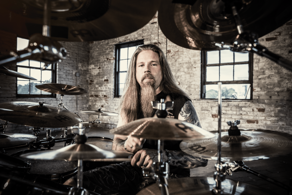 Chris Adler behind a drum kit